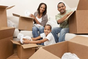 Image of family with moving boxes