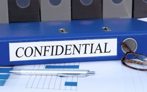 Image of a binder with a label that says confidential