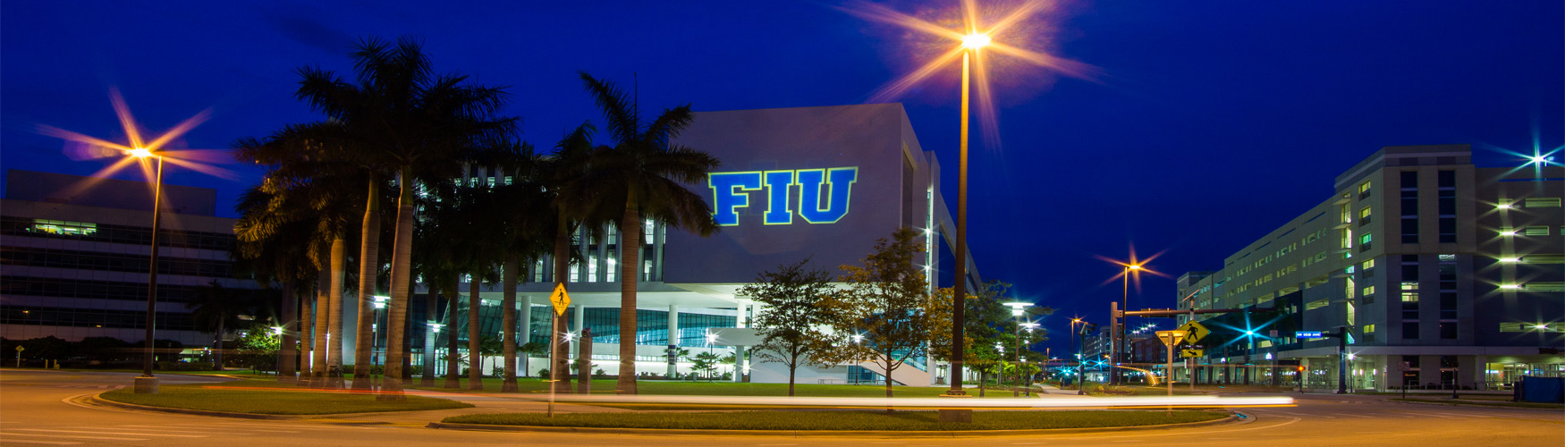 Building at night with FIU light projection